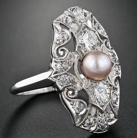 Edwardian natural pearl and diamond dinner ring. Via Diamonds in the Library.