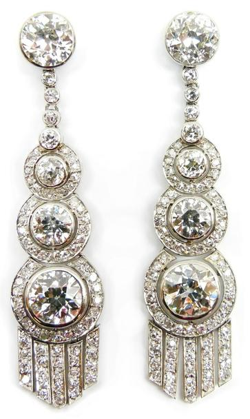 Graduated brilliant-cut diamond earrings, Art Deco or Art Deco style. Via Diamonds in the Library.