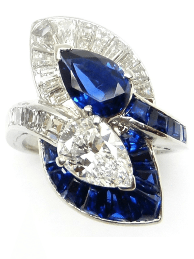 Two stone pear-shaped sapphire and diamond crossover ring. Via Diamonds in the Library.