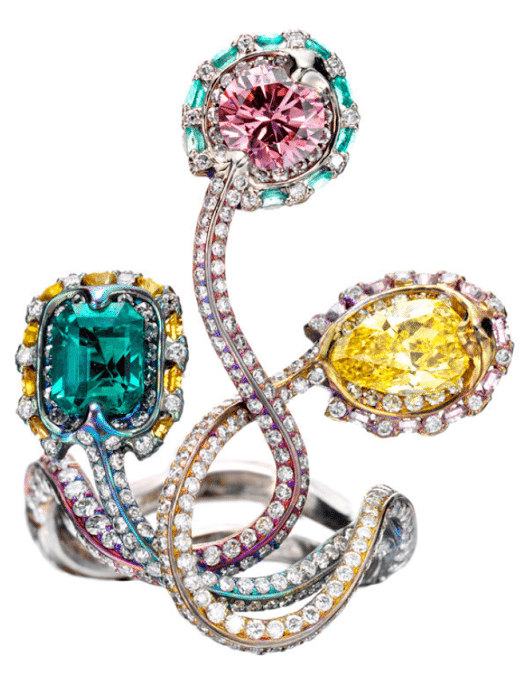 Wallace Chan diamond, colored diamond, and emerald ring. Via Diamonds in the Library.