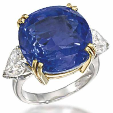 24.78 carat sapphire and diamond ring. Via Diamonds in the Library.
