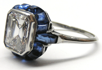 A stunning and unusual diamond and blue sapphire ring. Via Diamonds in the Library.