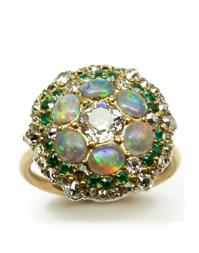 An antique opal, diamond, and emerald cluster ring, formerly a button. Circa 1820.