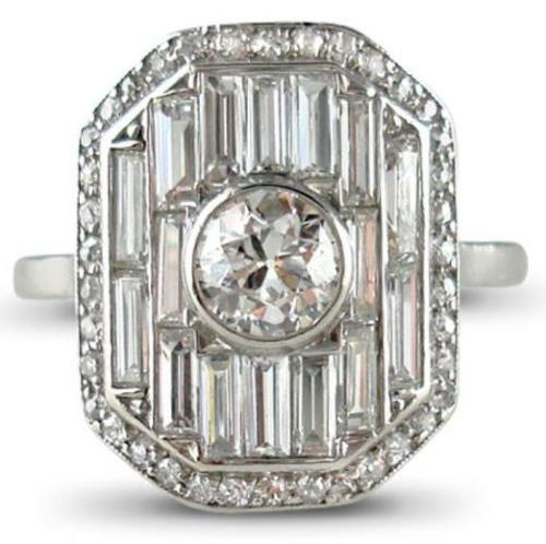 Art Deco diamond panel ring by Lacloche Freres. Via Diamonds in the Library.
