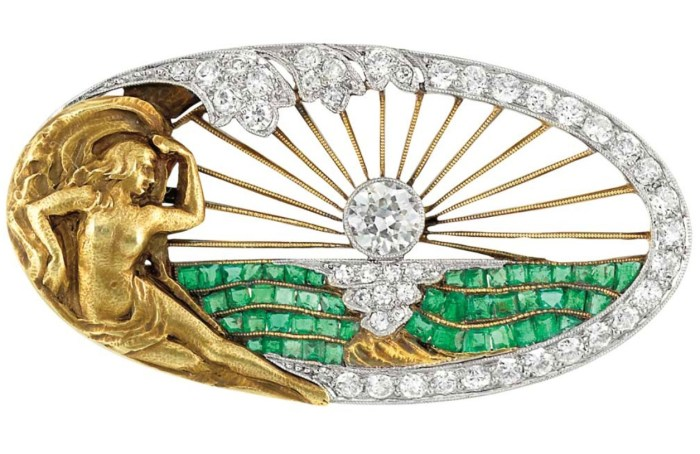 Art Nouveau sunrise brooch with diamonds and emeralds. Via Diamonds in the Library.