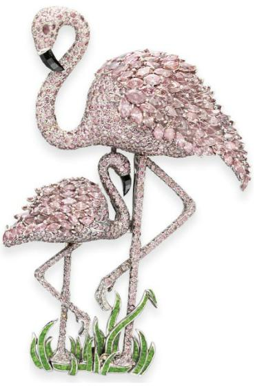 Pink diamond flamingo brooch, Carvin French. Designed as two detachable, pavé-set pink diamond flamingos extending marquise-cut pink diamond wings, with faceted black diamond beaks and cabochon ruby eyes. Via Diamonds in the Library.