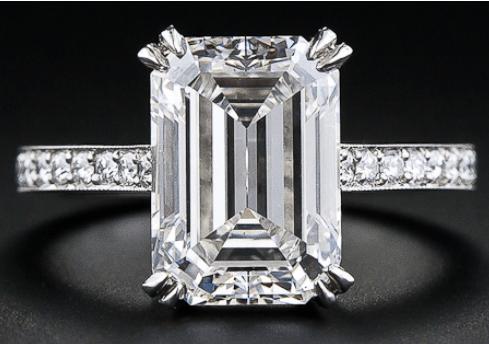 A 4.00 carat emerald-cut diamond engagement ring.