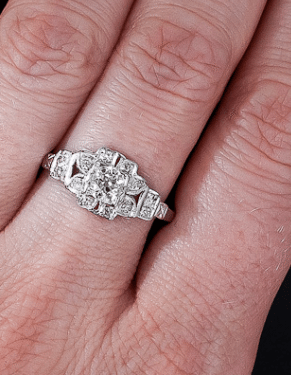 Antique floral Art Deco engagement ring, circa 1930's. Via Diamonds in the Library.