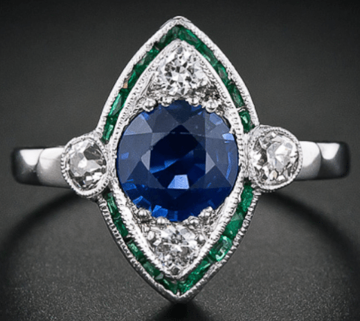 Art Deco navette-shaped emerald, sapphire, and diamond ring. Via Diamonds in the Library.