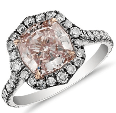 Blue Nile's 2.02 ct Fancy Purple Pink cushion-cut diamond halo ring. In platinum and rose gold with blue micropavé diamonds. Via Diamonds in the Library.
