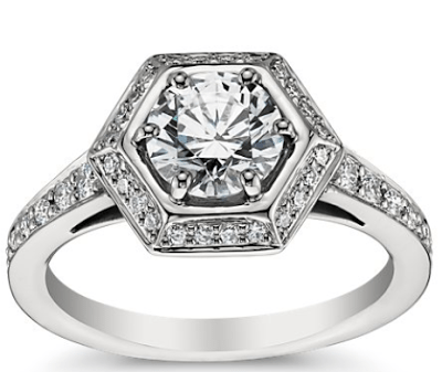 Blue Nile's vintage-inspired Hexagon Halo engagement ring in platinum with a round-cut diamond, embellished with 30 small diamonds. Via Diamonds in the Library.