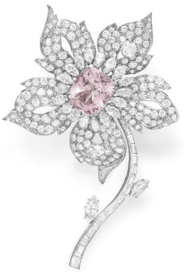 Boucheron diamond and kunzite flower brooch. Via Diamonds in the Library.