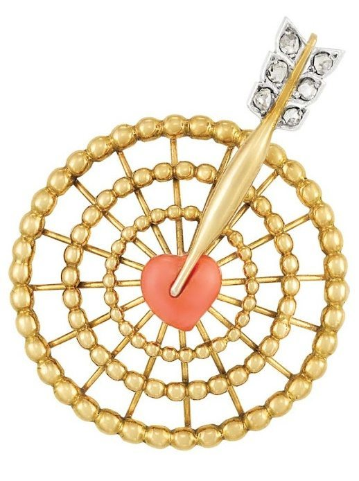 Gold, diamond, and coral bullseye brooch by Cartier. Paris, circa 1940. Via Diamonds in the Library.