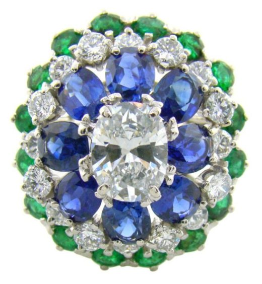 Oscar Heyman cocktail ring with a 1.38 carat diamond surrounded by 1.18 carats of additional diamonds and 6.29 carats total of emeralds and sapphires. Via Diamonds in the Library.
