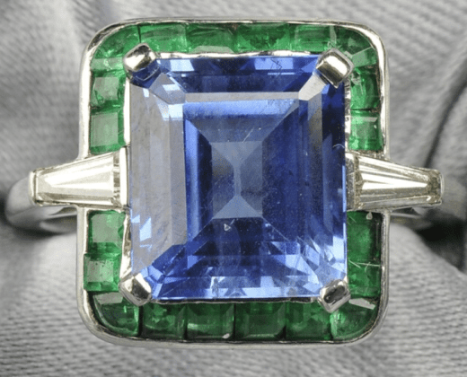 Sapphire, emerald, and diamond ring. Via Diamonds in the Library.