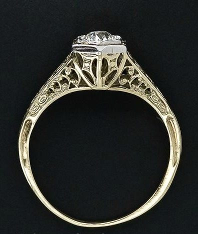 Side view; a vintage diamond filigree engagement ring. Via Diamonds in the Library.