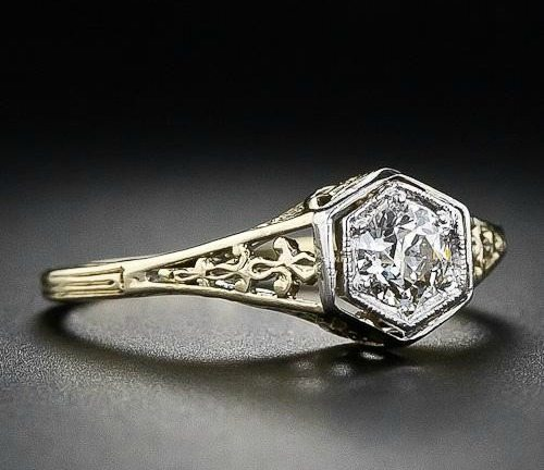 Tilted side view; a vintage diamond filigree engagement ring. Via Diamonds in the Library.