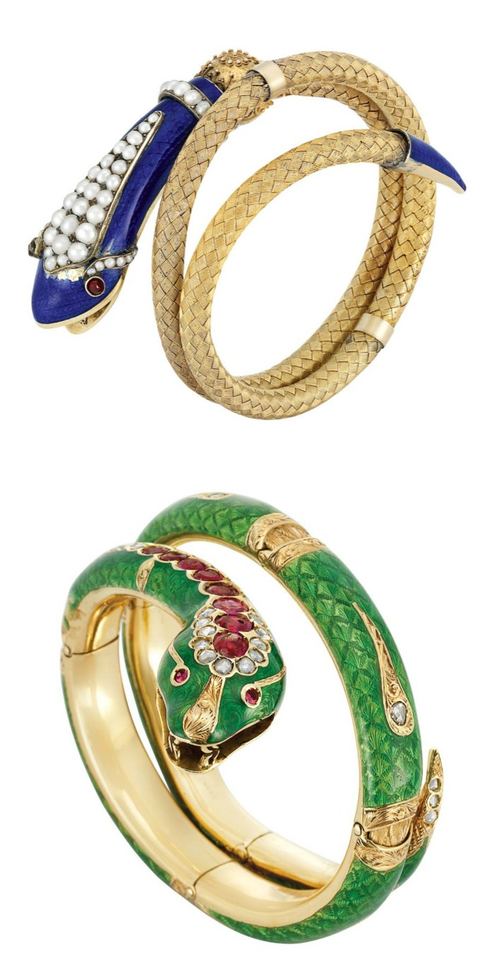 Two antique snake bangles in gold with gemstone, pearl, and enamel details.