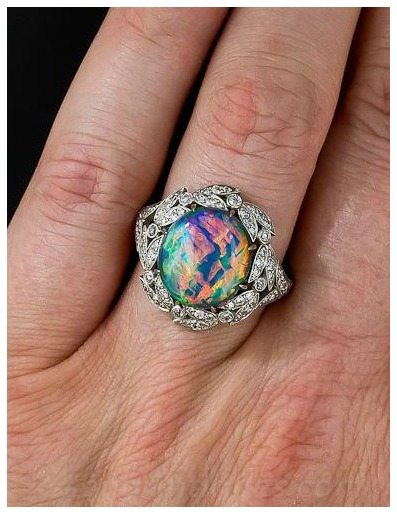 A beautiful fire opal and diamond ring from Lang Antiques