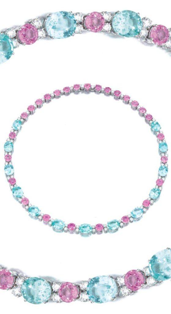 A wonderful diamond, pink sapphire, and pariaba tourmaline necklace, Michele Della Valle. Via Diamonds in the Library.