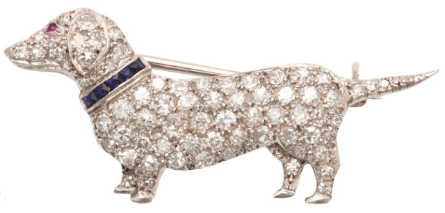 Art Deco Dachshund brooch by Cartier; platinum set with diamonds, sapphires, and rubies. Via Diamonds in the Library.