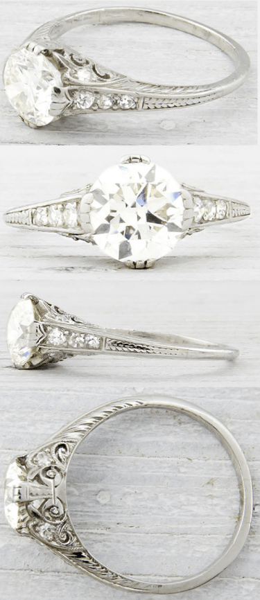 Art Deco engagement ring, circa 1930. Embellished with delicate engraving and sparkling side stones, this ring is centered by a 1.20 carat old European cut diamond.