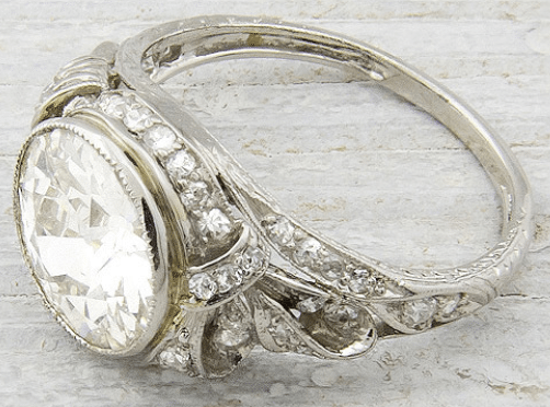 Edwardian or early Art Deco engagement ring, circa 1905. Set with 2.33 carat old European cut diamond with H-I color and SI1 clarity. Via Diamonds in the Library.