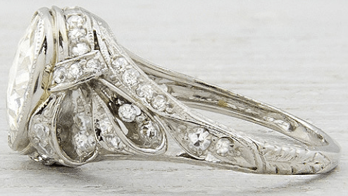 Side detail of a lovely Edwardian or early Art Deco engagement ring, circa 1905. Set 2.33 carat old European cut diamond. Via Diamonds in the Library.