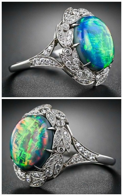 Side view; a fire opal and diamond ring. Via Diamonds in the Library.