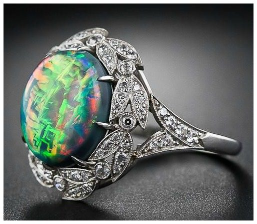 Side view; another angle of the fire opal and diamond ring from Lang Antiques. Via Diamonds in the Library.