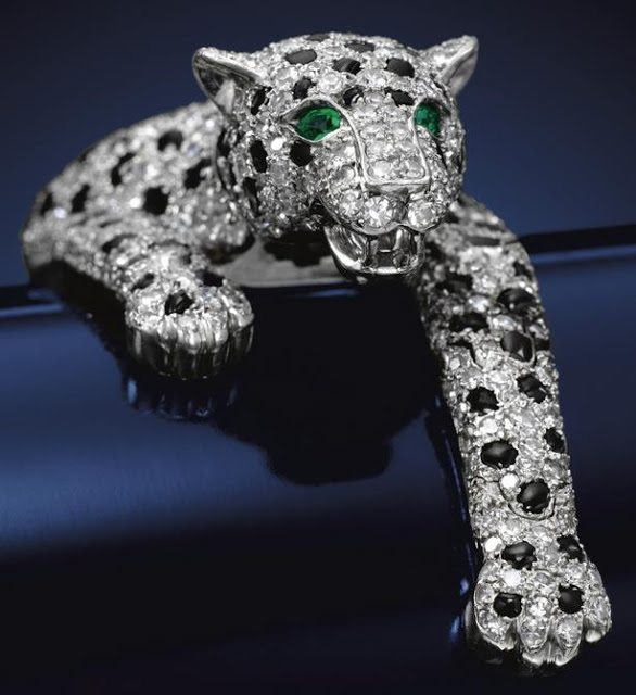 The Duchess of Windsor's Cartier panther bracelet. The fully-articulated bracelet, made by Cartier in 1952, is pavé-set with brilliant- and single-cut diamonds and calibré-cut onyx.