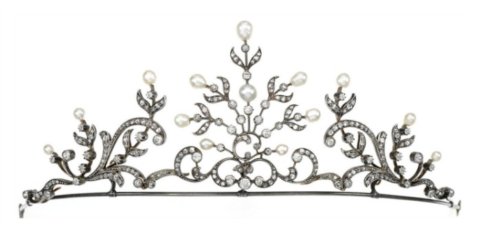 A dainty pearl and diamond tiara designed as a series of scroll and stylized foliate motifs, set with pearls, circular-cut and rose diamonds. It can also be worn as a necklace.