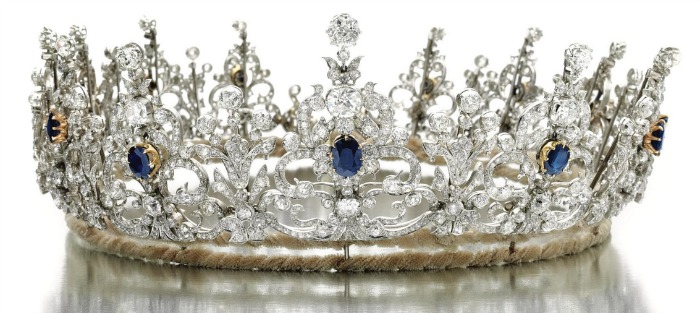 A gold, sapphire, and diamond tiara from the early 1900's. This piece is designed as a series of thirteen graduated stylized ribbon and scroll elements.