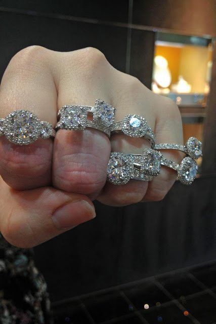 A hand covered in beautiful diamond engagement rings by Tacori. Via Diamonds in the Library.
