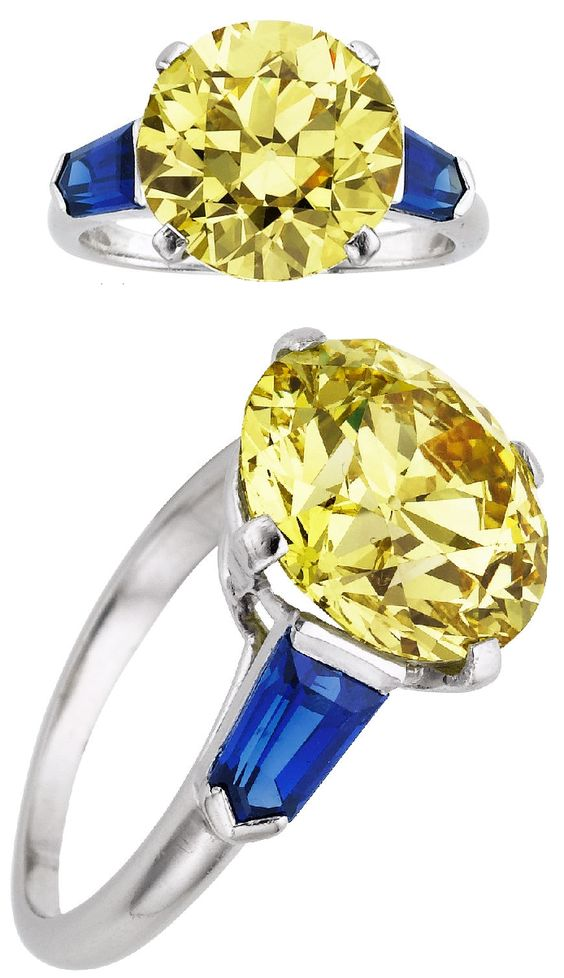 Art Deco Cartier yellow diamond and sapphire ring. It features a 5.50 ct European-cut fancy intense yellow diamond flanked on either side by shield-cut sapphires weighing a total of 1.20 cts.
