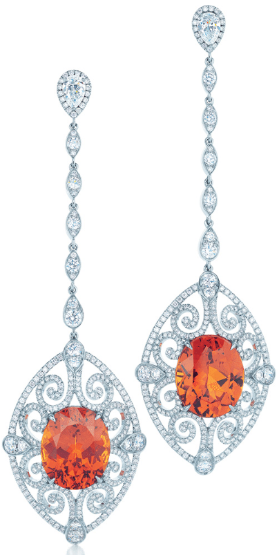 Tiffany & Co. earrings with oval spessartites glowing within scrollwork of diamonds in platinum. From the 2013 Tiffany & Co. Blue Book Collection. Via Diamonds in the Library.