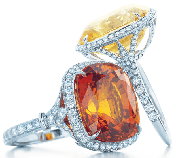 Two gemstone and diamond rings by Tiffany & Co.; one with a yellow sapphire and one with an orange sapphire. From the 2013 Tiffany & Co. Blue Book Collection. Via Diamonds in the Library.