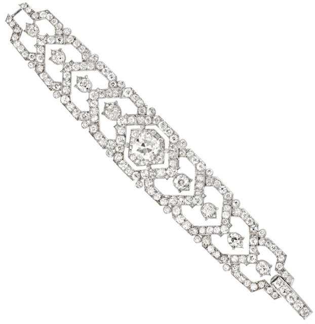 A 1940's diamond bracelet by Cartier. It centers a cushion-cut diamond, with two concentric old mine and old European-cut diamond hexagonal-shaped surrounds.