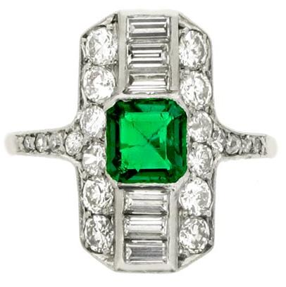 Art Deco emerald and diamond ring, circa 1925. The emerald is .8 carat, and the total diamond weight is 1.12 carats. Via Diamonds in the Library.