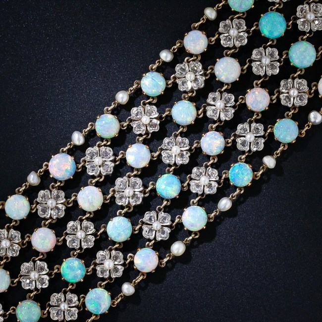 Detail: Belle Epoque opal and diamond choker necklace, circa 1900. With four rows of opals and three rows of pearl and diamond flowers, this antique choker has 80 carats of opals (78 stones), 232 rose cut diamonds (7 carats), and 96 pearls. Via Diamonds in the Library.