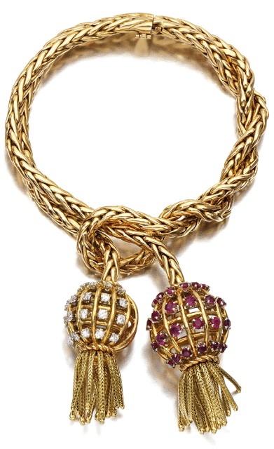 Retro gold, ruby, and diamond tassel bracelet by Sterlé, circa 1950. Via Diamonds in the Library.