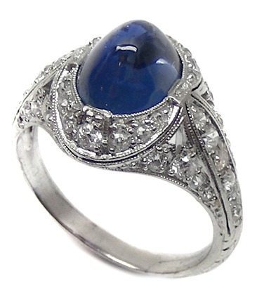 A beautiful cabochon sapphire and diamond ring. Art Deco era.