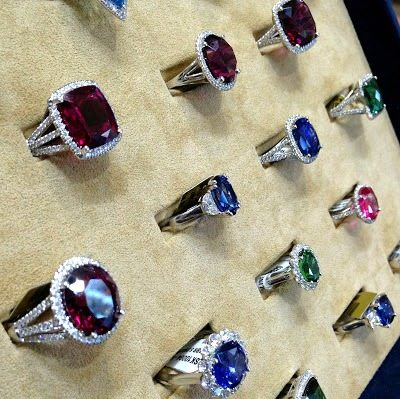 A whole lovely tray of gemstone and diamond rings by Coast Diamond. Via Diamonds in the Library.