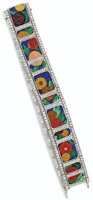 Antique Art Deco carved hardstone and diamond bracelet with diamonds, coral, carnelian, chalcedony, malachite and lapis lazuli. Circa 1925.
