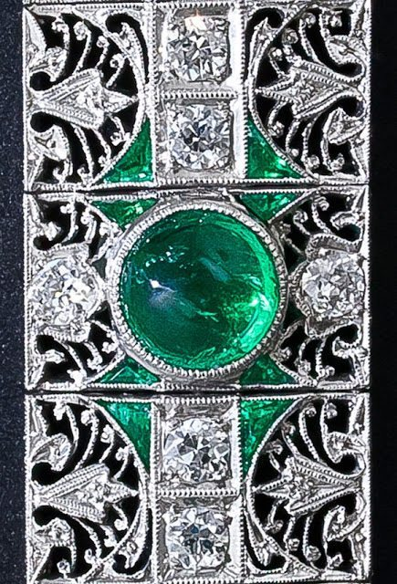 Detail view of an antique emerald and diamond bracelet, circa 1910-1920. Via Diamonds in the Library.