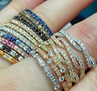 Gemstone stacking rings and diamond wedding bands in rose, white, and yellow gold, all at Mervis Diamond Importers. Via Diamonds in the Library.