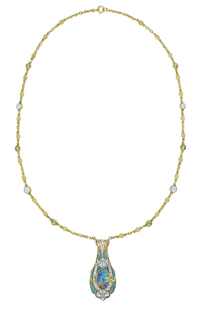 Tiffany & Co. Art Nouveau necklace with a gold, enamel, and black opal pendant on a peridot and white opal-studded gold chain. Circa 1900. Via Diamonds in the Library.