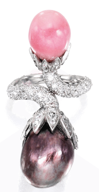 A natural pearl, conch pearl, and diamond ring. Via Diamonds in the Library.