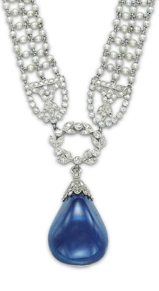 Detail of an antique Edwardian seed pearl, sapphire, and diamond sautoir by Cartier, circa 1910s. Via Diamonds in the Library.
