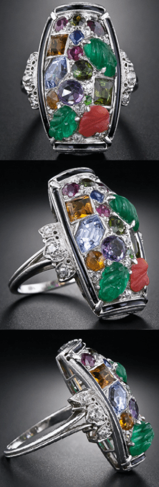 Tutti-frutti Art Deco dinner ring, circa 1925. An unusual design incorporating carved emeralds, sapphires, rubies, amethysts, citrines, and diamonds within a border of black enamel.